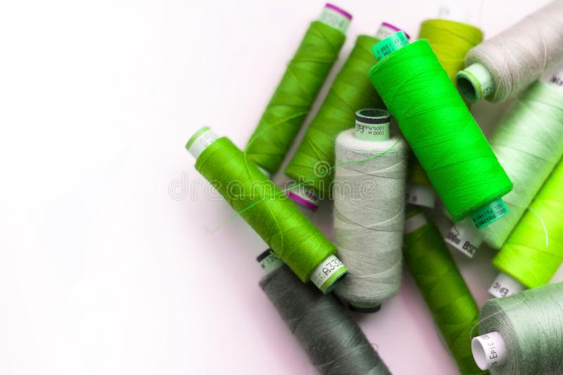 A bunch of sewing thread reels. A closeup photo of colorful sewing thread reels royalty free stock photography