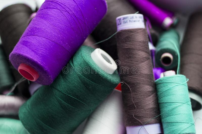 A bunch of sewing thread reels. A closeup photo of colorful sewing thread reels royalty free stock image