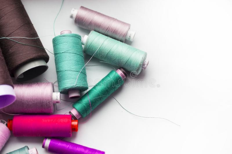 A bunch of sewing thread reels. A closeup photo of colorful sewing thread reels stock image