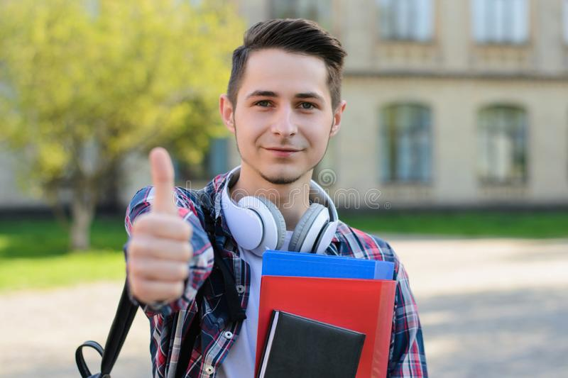 Closeup photo of excited clever intelligent guy demonstrating finger up symbol to you royalty free stock photography