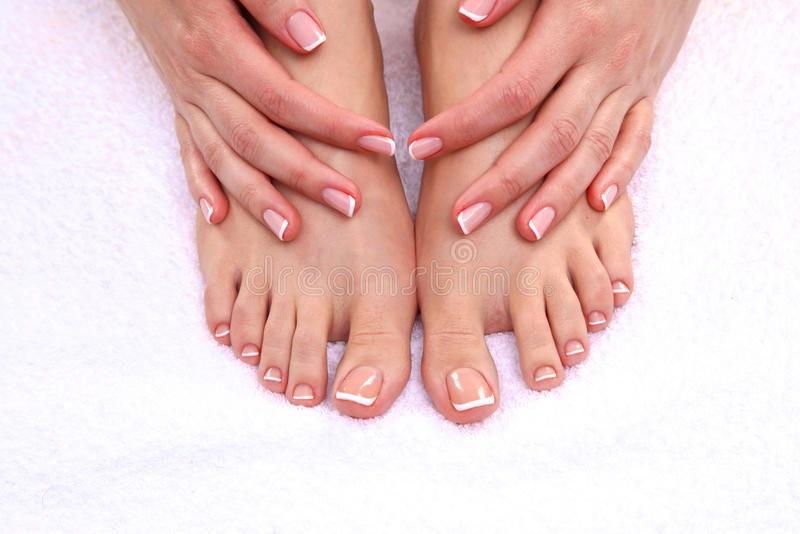 Closeup photo of a female feet at spa salon on pedicure procedure royalty free stock images
