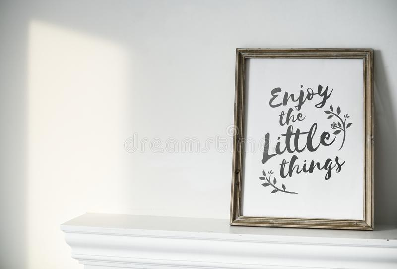 Closeup of photo frame on white wall stock image