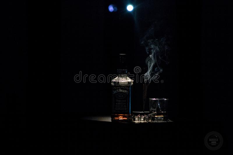 Closeup Photo of Liquor Bottle Against Black Background royalty free stock photos