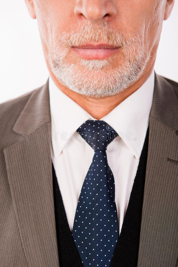 Closeup photo of old businessman in an elegant business suit with beard royalty free stock image