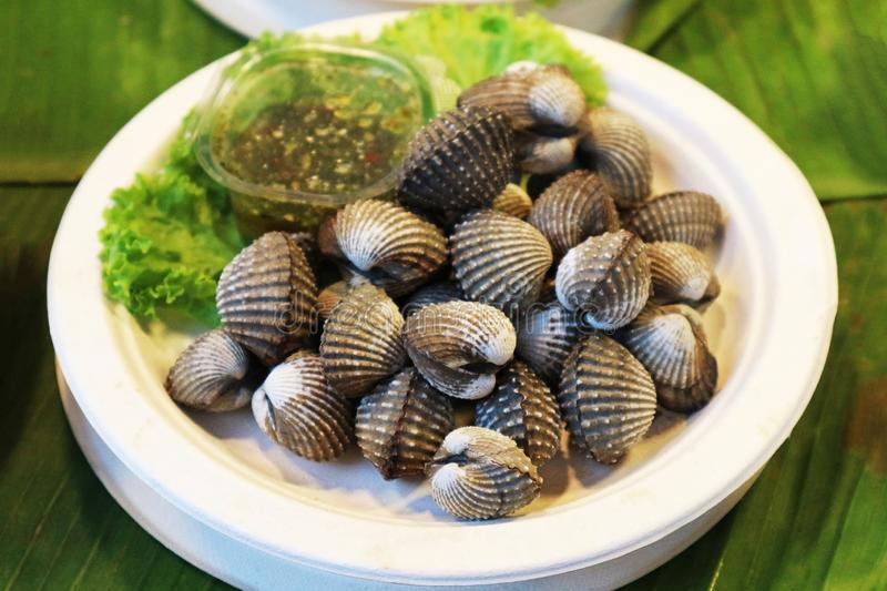 Parboiled Cockles with Green Chili Sauce stock images