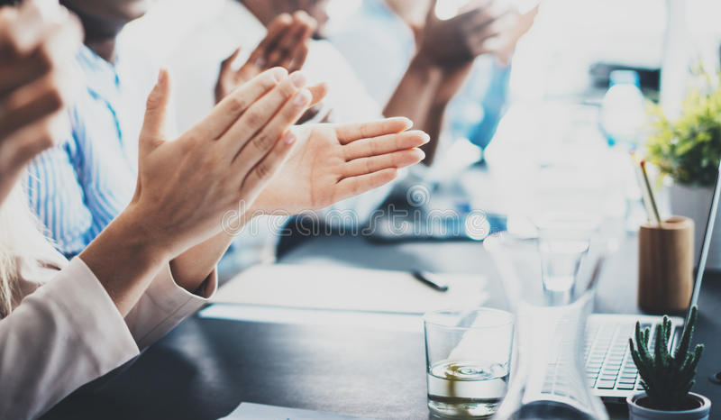 Closeup photo of partners clapping hands after business seminar. Professional education, work meeting, presentation or stock image