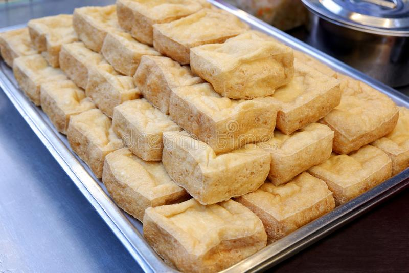 Delicious Golden Brown Crispy Tofu Cubes royalty free stock image