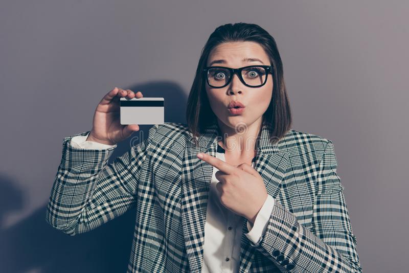 Closeup photo portrait of amazed she her lady holding showing plastic card in hands wearing checkered plaid with collar stock photo