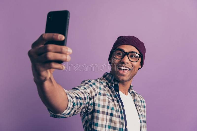 Closeup photo portrait of funny funky excited cheerful positive handsome nice with white toothy smile millennial making stock photo