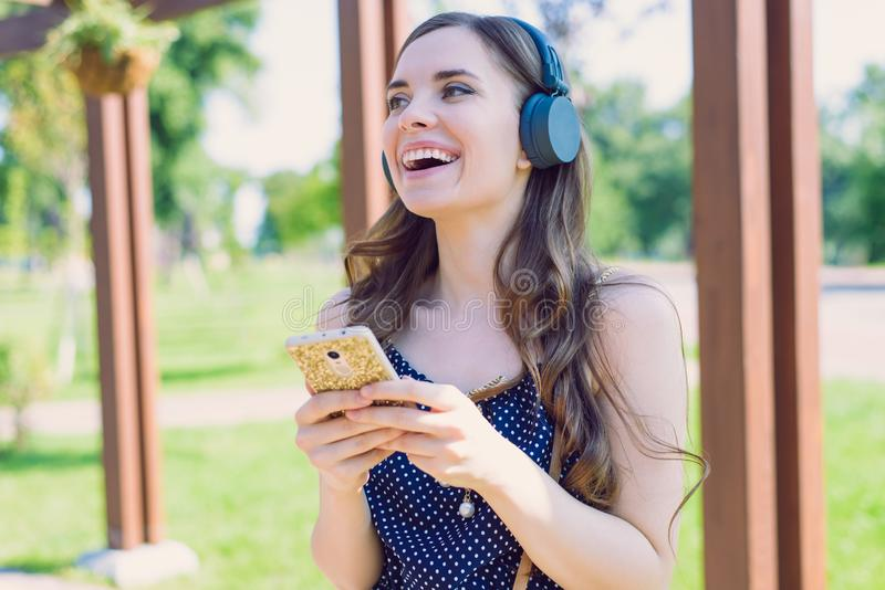 Closeup photo portrait of pretty optimistic funny funky pretty wearing dotted retro dress lady using telephone for finding. Favorite melody song singing hearing royalty free stock photos
