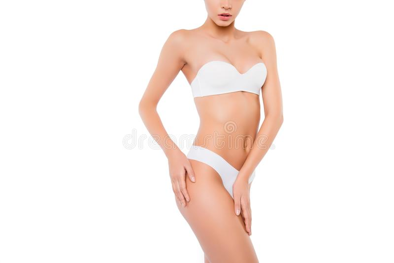 Closeup photo of slim woman with perfect body in underwear. Isolated on white background copy space. Cropped close up photo portra stock images