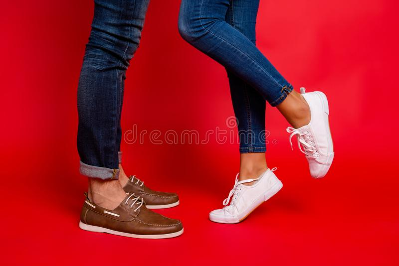Closeup photo of woman and man legs in jeans, pants and shoes, g stock photos