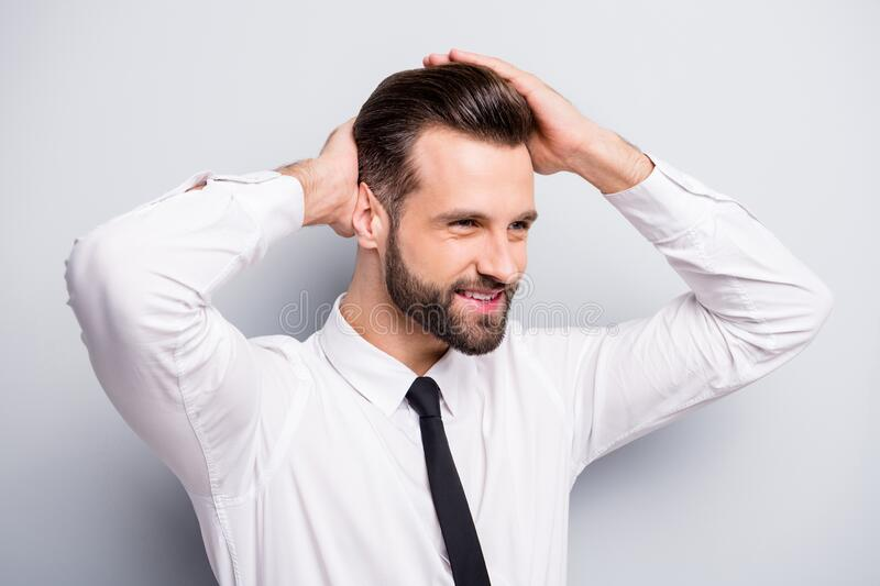 Closeup photo of young macho business man touch groomed neat hairstyle salon styling beaming smiling look empty space stock images