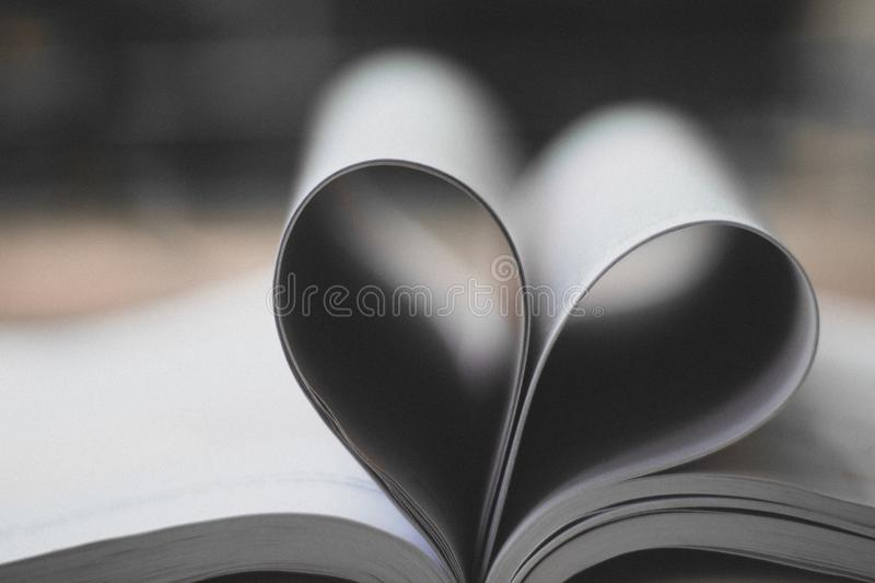 Closeup Photography of Book Page Folding Forming Heart stock photo