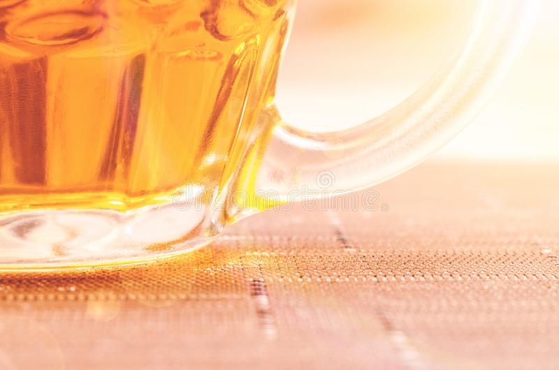 Closeup Photography of Clear Glass Beer Mug Filled With Yellow Liquid royalty free stock image