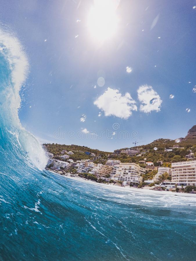 Closeup Photography of Sea Wave Near Concrete Building at Daytime royalty free stock photography