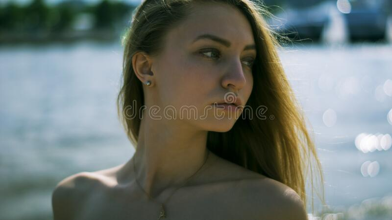 Closeup Photography of Woman With Gold Necklace Near Body of Water during Daytime stock images