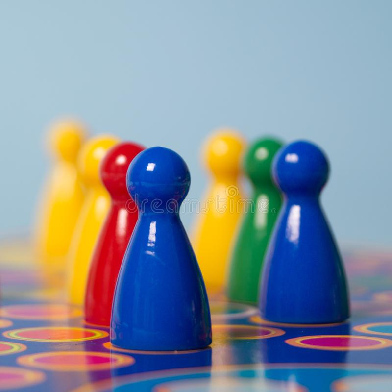 Closeup Photography of Yellow, Red, Green, and Blue Chess Piece stock image