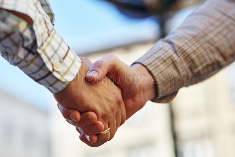 A businesspeople shaking hands, making an agreement. royalty free stock photography