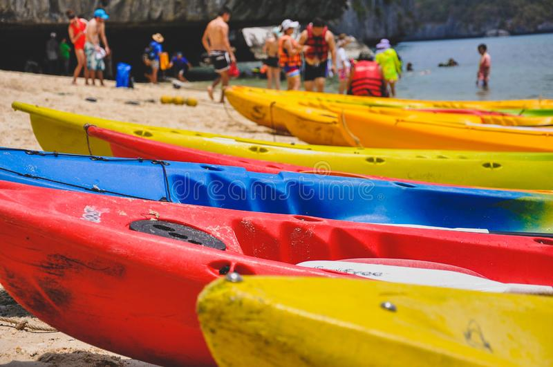 Closeup picture of colourful canoes parking on the beach stock image