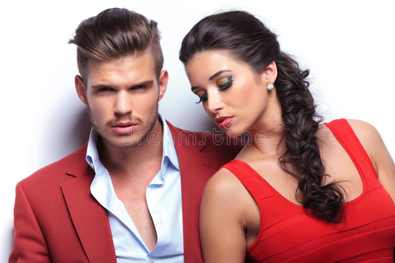 Closeup picture of an embraced in love couple. Men looking at the camera stock image