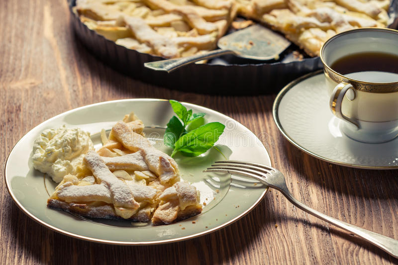 Closeup of piece of apple pie served with coffee stock images