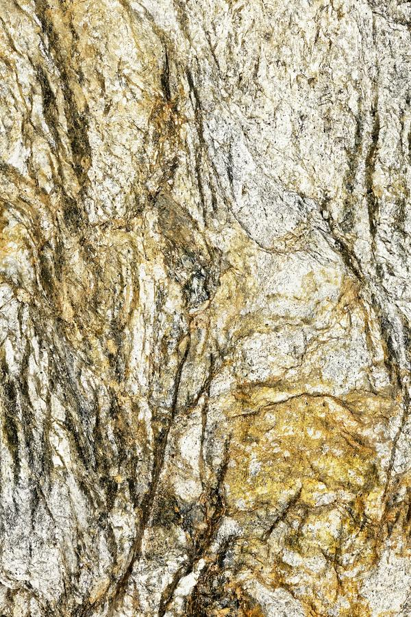 Abstract Lines on lump of golden Rock. Closeup of piece of stone found in the austrian alps looks like abstract painting or prehistoric painting in caves royalty free stock photography