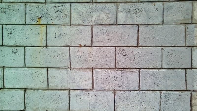 Closeup of a piece of white brick wall. stock photos