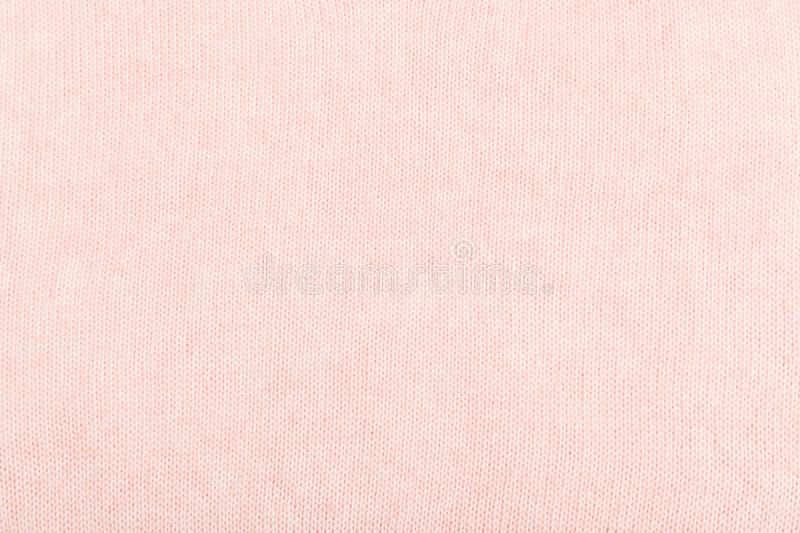Closeup of pink knitted fabric texture. facial loops. stockings with knitting needles and pink woolen thread. Closeup of pink knitted fabric texture.  stockings royalty free stock image