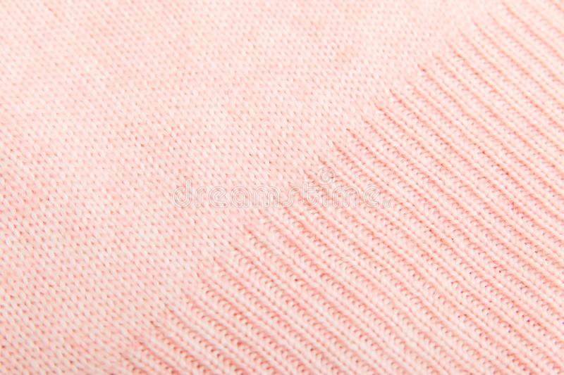 Closeup of pink knitted fabric texture. facial loops. stockings with knitting needles and pink woolen thread. Closeup of pink knitted fabric texture.  stockings stock photo