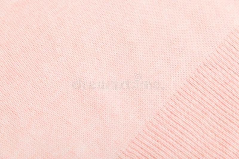 Closeup of pink knitted fabric texture. facial loops. stockings with knitting needles and pink woolen thread. Closeup of pink knitted fabric texture. stockings royalty free stock images