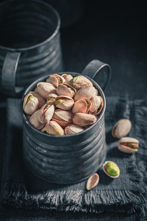 Closeup of pistachios in a rustic metal box royalty free stock images