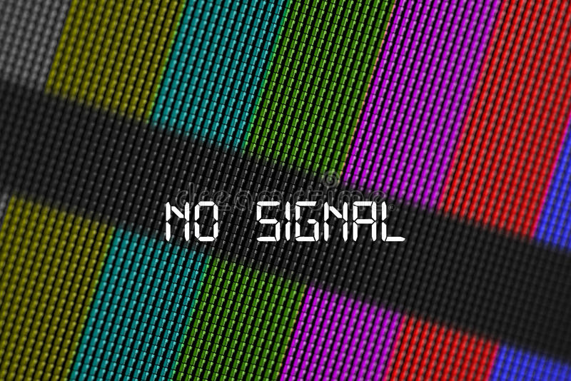 Closeup pixels of LCD TV screen with color bars and message no signal is a television test pattern. Close up pixels of LCD TV screen with bars is a television stock image