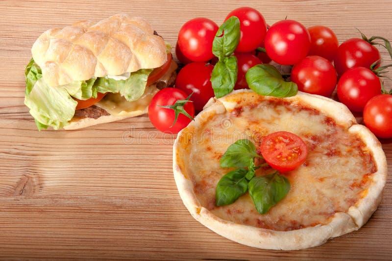 Closeup of pizza with hamburger royalty free stock photo