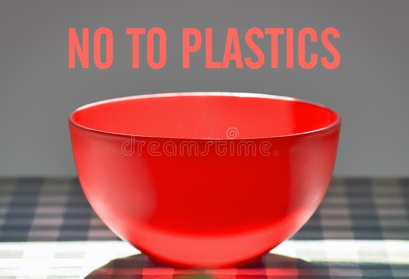 No to plastics. Closeup of a plastic bowl on the table and text No To Plastics royalty free stock photos