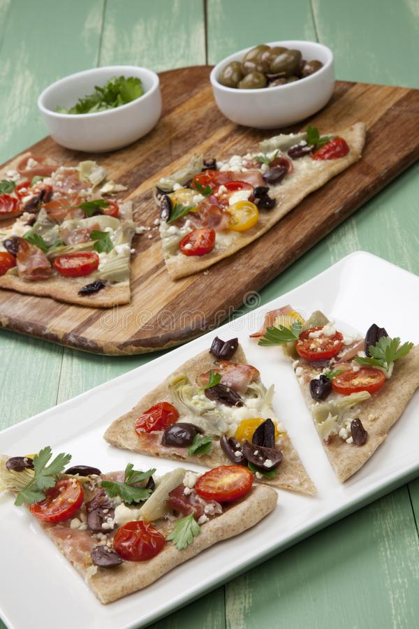 Home Made Mediterranean Prosciutto Flatbread royalty free stock photography
