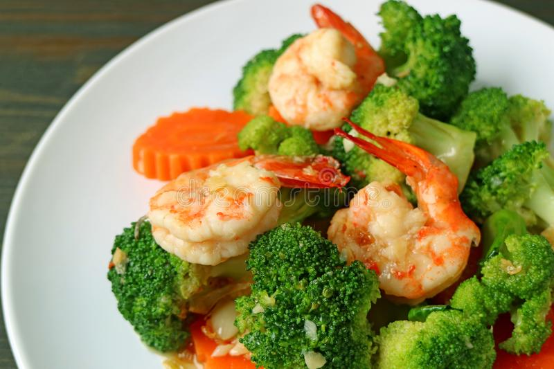 Closeup a plate of prawn stir fried with broccoli garlic and carrot royalty free stock photos
