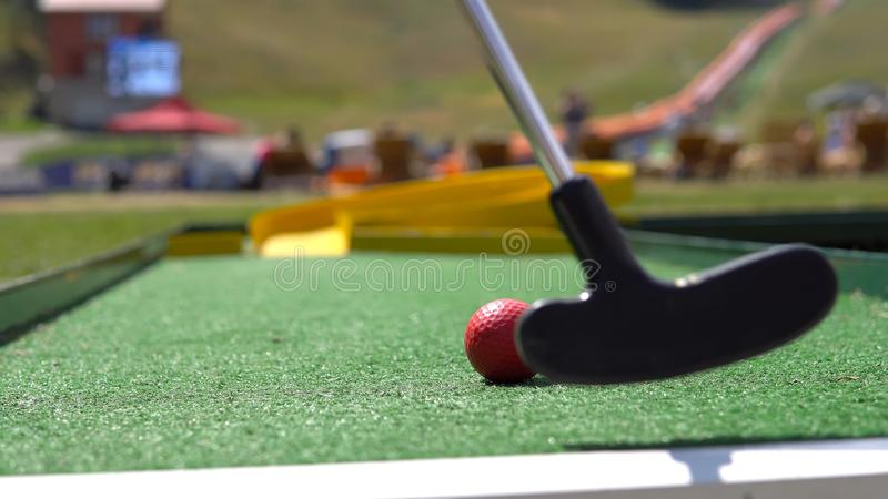 Closeup of player play mini golf royalty free stock images