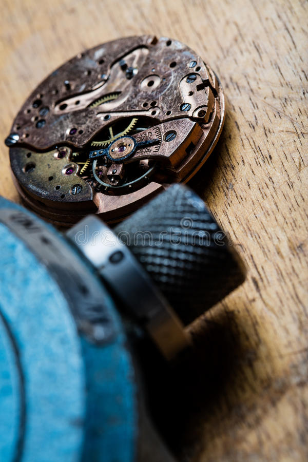 Closeup of pocket watch mechanism and clockworks. On the table of a clockmaker royalty free stock image