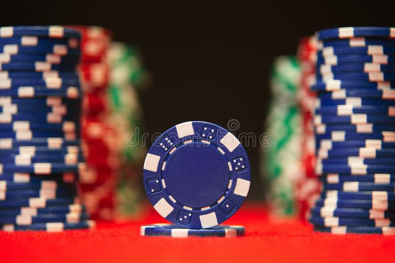 Closeup of poker chips on red felt card table surface royalty free stock image