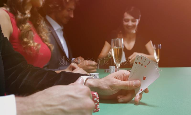 Closeup of poker hand of aces in pastel colors royalty free stock photos