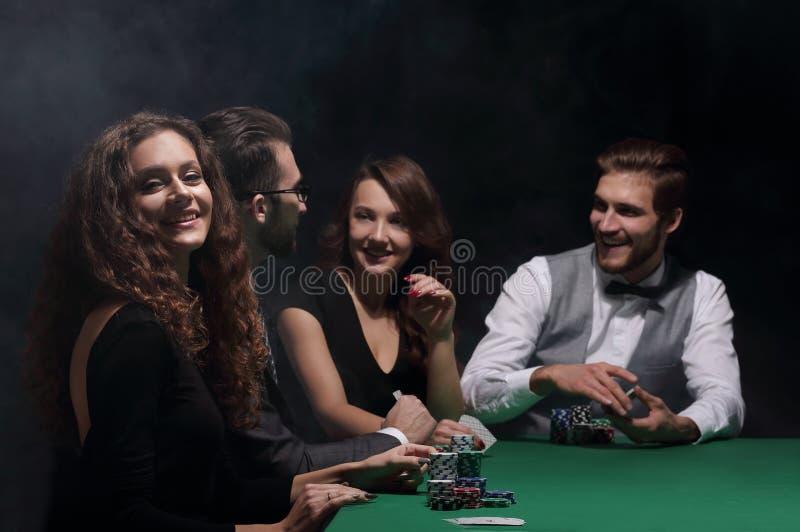 Closeup.poker players sitting at a casino table stock photos
