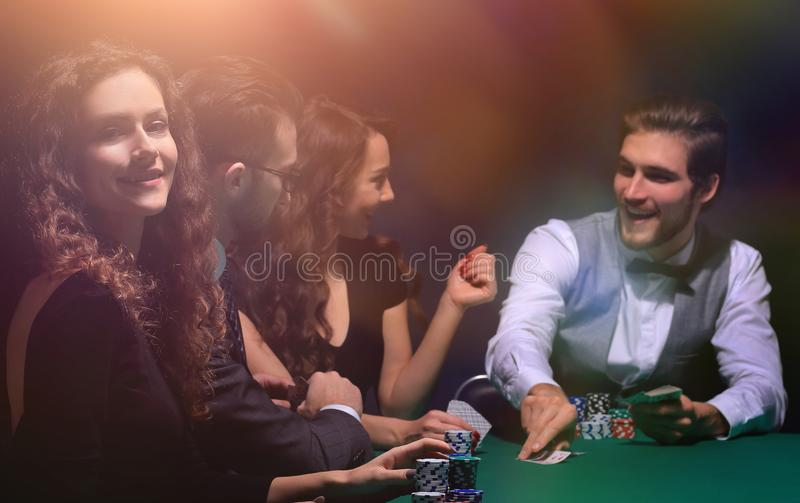 Closeup.poker players sitting at a casino table royalty free stock photo