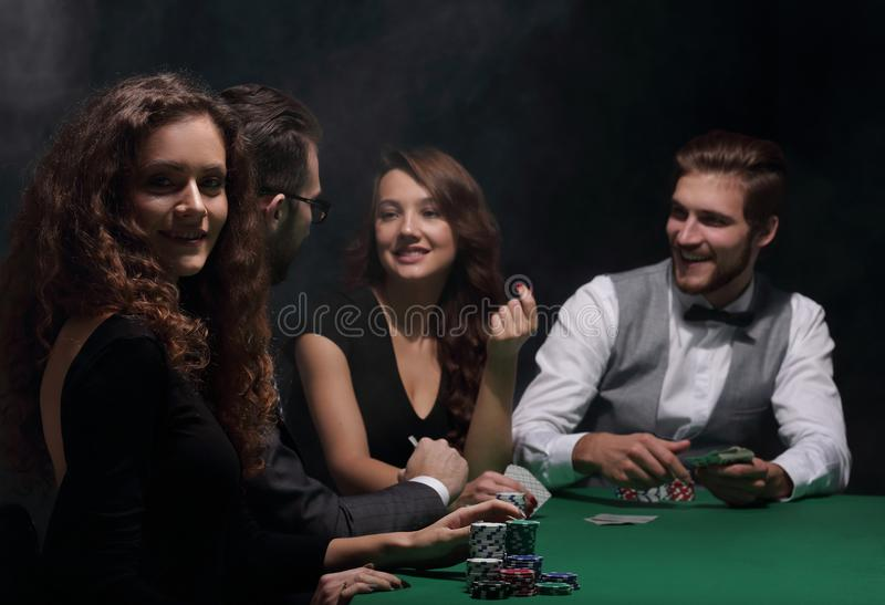 Closeup.poker players sitting at a casino table royalty free stock images