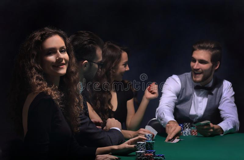 Closeup.poker players sitting at a casino table royalty free stock photography