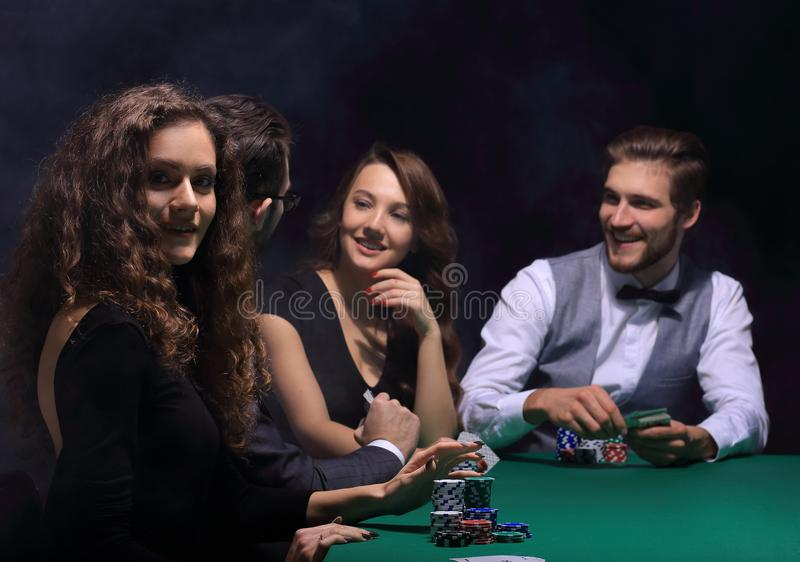 Closeup.poker players sitting at a casino table stock photo