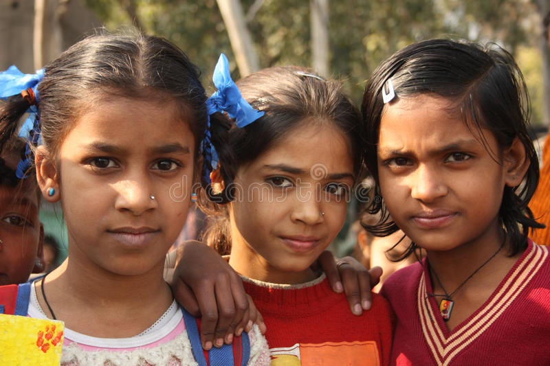 Closeup of poor indian children girls. Closeup of poor girls from a urban slum of Delhi, India royalty free stock image