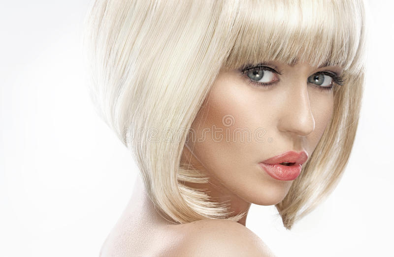 Closeup portrait of an adorable blond woman royalty free stock photo