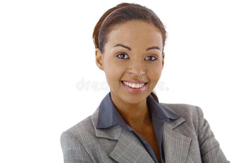 Closeup portrait of afro businesswoman. Closeup studio portrait of afro businesswoman smiling at camera stock photography