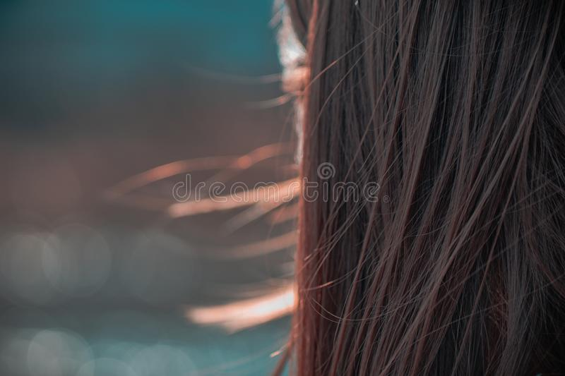 Street closeup portrait of amazing smiling girl with long hair and super beautiful brown eyes stock photography